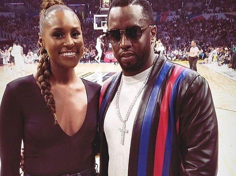 Alicia Keys e Sean Combs, quando ele ainda era o Puff Daddy, em uma partida da NBA